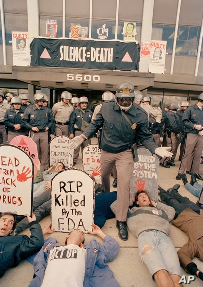 Demonstrators from the organization ACT UP, angry with the federal government's response to the AIDS crisis, protest in front…