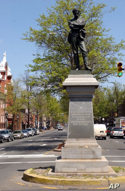 FILE - This April 23, 2003 file photo shows a statue of a Confederate soldier at an intersection in Alexandria, Va. A city…