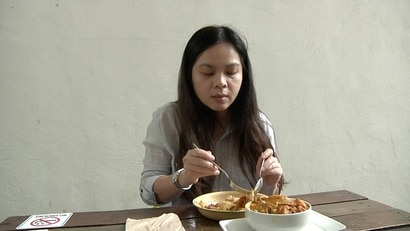 """Amy Loh works near Swee Bee by Baker Dave, and has been a regular at the cafe for more than three years. """"It's not just about the food and everything, it's about the relationship with them as well,"""" she says. (Dave Grunebaum/VOA)"""