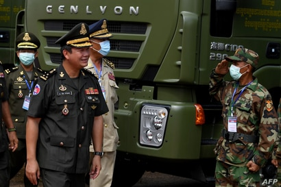 FILE - Son of Cambodian Prime Minister Hun Sen, Lt. Gen. Hun Manet, inspects military vehicles at ceremony at the National Olympic Stadium in Phnom Penh, Cambodia, June 18, 2020.