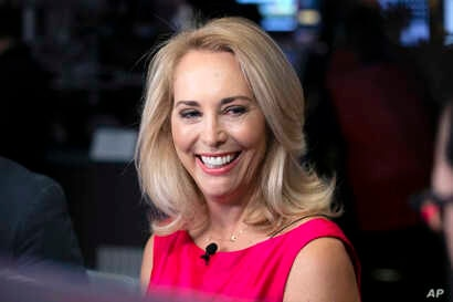 FILE - former CIA operative Valerie Plame is interviewed on the floor of the New York Stock Exchange, Oct. 22, 2018.