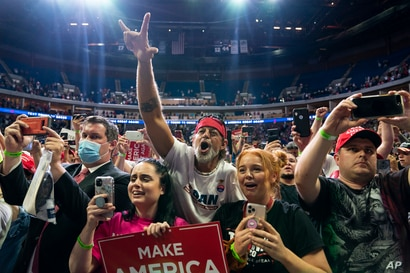 Supporters of President Donald Trump cheer as he arrives on stage to speak to a campaign rally at the BOK Center, June 20, 2020, in Tulsa, Oklahoma.