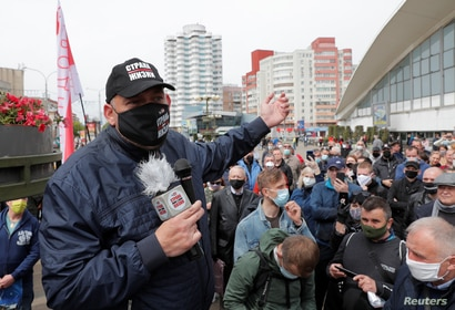 FILE - Blogger Sergei Tikhanovsky speaks during a rally of supporters of opposition politicians amid the coronavirus pandemic, in Minsk, Belarus May 24, 2020.