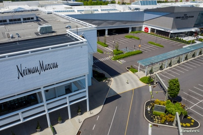 A Neiman Marcus department store stands next to empty parking lots at the King of Prussia Mall which remains closed due to the ongoing outbreak of the COVID-19 in Upper Merion Township, Pennsylvania, May 21, 2020.