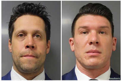 Buffalo Police officers Aaron Torgalski, left, and Robert McCabe, who were arraigned on felony assault charges, are seen in this combination of photographs provided by the Erie County District Attorney's Office in Buffalo, New York, June 6, 2020.