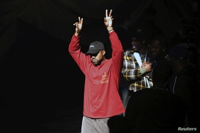 """Kanye West acknowledges attendees before his Yeezy Season 3 Collection presentation and listening party for the """"The Life of…"""