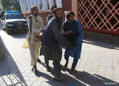 ATTENTION EDITORS - VISUAL COVERAGE OF SCENES OF INJURY OR DEATH Afghan men carry a wounded person to the hospital after a…