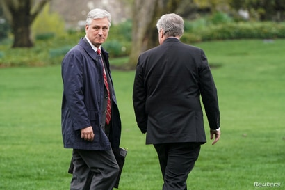 National Security Advisor Robert O'Brien walks with White House Chief of Staff Mark Meadows as U.S. President Donald Trump…