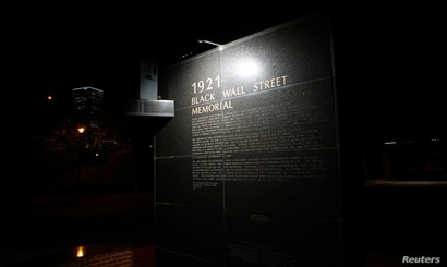 A monument to the 1921 Black Wall Street massacre is pictured in Tulsa, Oklahoma, U.S., June 18, 2020. Picture taken June 18,…