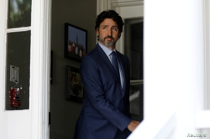FILE - Canada's Prime Minister Justin Trudeau arrives for a news conference in Ottawa.