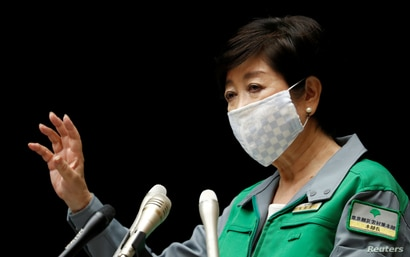 Tokyo Governor Yuriko Koike gestures as she attends a joint news conference with Japan's Economy Minister Yasutoshi Nishimura…