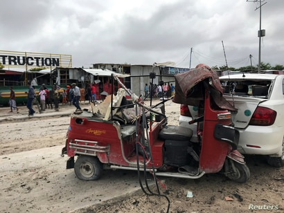 A wreckage of a rickshaw and a car destroyed are seen at the scene of an explosion in Mogadishu, Somalia July 13, 2020. REUTERS…