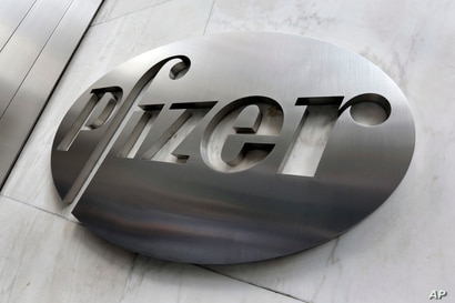 FILE - This file photo shows the Pfizer company logo at the company's headquarters in New York.