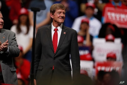 U.S. Rep. Scott Tipton, R-Colo., listens as President Donald Trump speaks at a campaign rally Thursday, Feb. 20, 2020, in…