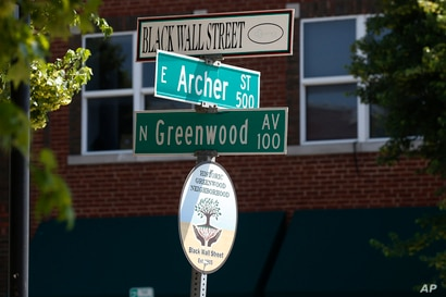 FILE - In this Monday, June 15, 2020, file photo, a sign marks the intersection of Greenwood Avenue and Archer Street, the…