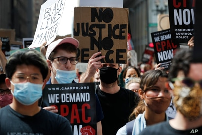 Protesters march around Chicago's City Hall, Wednesday, June 17, 2020, demanding that Mayor Lori Lightfoot enact the ordinance…