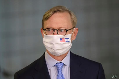 US special envoy for Iran, Brian Hook, attends a press briefing with Israeli Prime Minister Benjamin Netanyahu while wearing a…