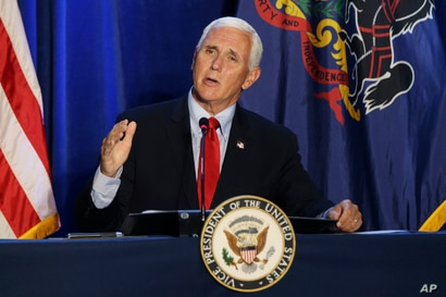 Vice President Mike Pence speaks during a roundtable discussion on reopening the economy at Rajant Corporation, which makes…
