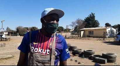 Business owner and ZANU-PF supporter Samson Malibho says he was against the protests because they affect his business of mending tires in Highfields, one of Harare's poorest suburbs, July 31, 2020.  (Columbus Mavhunga/VOA)