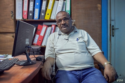 Taher Omar, an Ethiopian refugee and community leaders says complaints about racist incidents come in daily to his office in Cairo on July 27, 2020. (VOA/Hamada Elrasam)