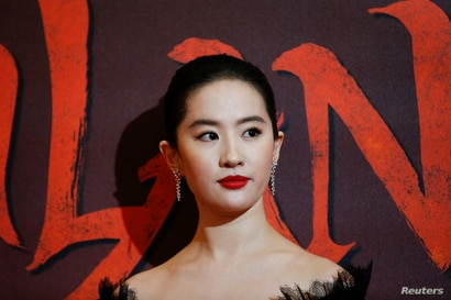 Cast member Yifei Liu poses at the European premiere for the film