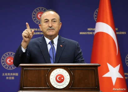 Turkish Foreign Minister Mevlut Cavusoglu attends a press conference in Ankara, Turkey, August 25, 2020. Turkish Foreign…