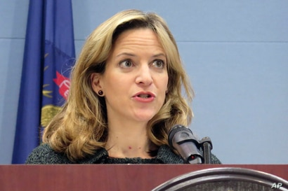 FILE - In this March 5, 2020 file photo, Michigan Secretary of State Jocelyn Benson speaks at a news conference in Lansing,…