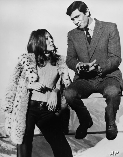 Actor George Lazenby, the new James Bond, and the former Emma Peel, British actress Diana Rigg, share a moment during takes of …