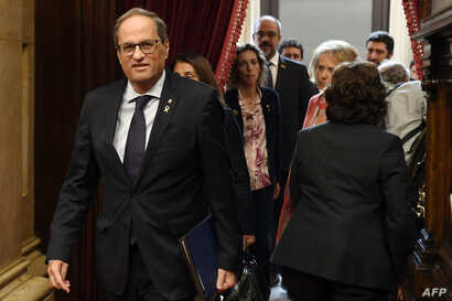 Catalan regional president Quim Torra arrives for addressing the chamber during a plenary session at the parliament in…