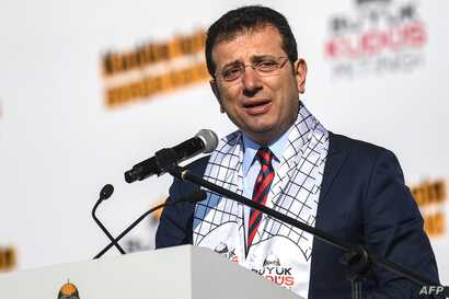 Ekrem Imamoglu , Mayor of Istanbul metropolitan municipality speaks during a rally at Yenikap? Square, in Istanbul, to protest…
