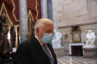 US Democratic Representative from Maryland, Steny Hoyer, wears a face mask as he walks out of the House chamber during the…