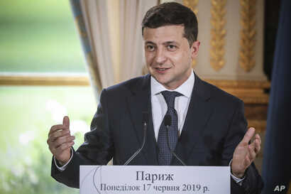 Ukrainian President Volodymyr Zelenskiy, delivers a speech during a press conference with French President Emmanuel Macron, at the Elysee Palace, in Paris, Monday, June 17, 2019. (Ludovic Marin/Pool via AP)