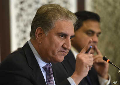 Pakistani Foreign Minister Shah Mahmood Qureshi addresses a news conference in Islamabad, Pakistan, Aug. 8, 2019.
