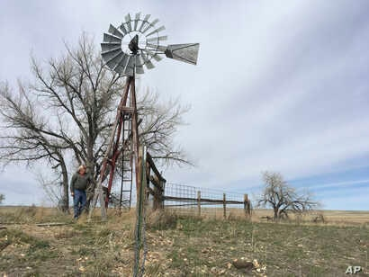 In this photo taken March 29, 2017, rancher L.J. Turner stands near a water well he says has run dry on his spread south of Gillette, Wyoming because of coal mining and coal-bed methane drilling in the area. Many locals say after 500 coal-mine…