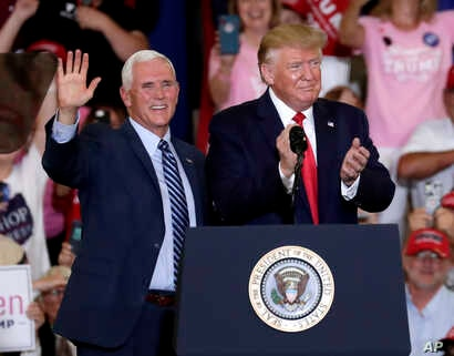 Vice President Mike Pence, left, and President Donald Trump greet the crowd at a rally in Fayetteville, N.C., Monday, Sept. 9, 2019 (AP Photo/Chris Seward)
