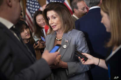 House Speaker Nancy Pelosi speaks with members of the media following a news conference on Hong Kong Human Rights on Capitol Hill in Washington, Wednesday, Sept. 18, 2019. (AP Photo/Pablo Martinez Monsivais)