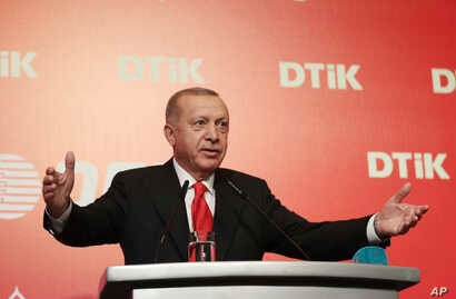 Turkey's President Recep Tayyip Erdogan addresses the World Turkish Business Council meeting, in Baku, Azerbaijan, Monday. Oct…