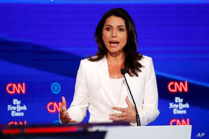Democratic presidential candidate Rep. Tulsi Gabbard, D-Hawaii, participates in a Democratic presidential primary debate  at Otterbein University, Oct. 15, 2019, in Westerville, Ohio.