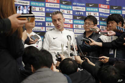 South Korean national soccer team head coach Paulo Bento answers a reporter's question upon his arrival after the soccer match…