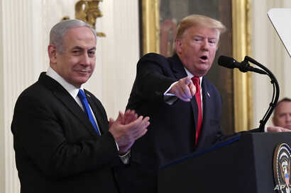 President Donald Trump speaks during an event with Israeli Prime Minister Benjamin Netanyahu in the East Room of the White…