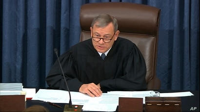 In this image from video, presiding officer Chief Justice of the United States John Roberts speaks during the impeachment trial…