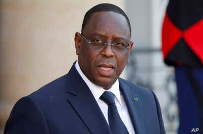 Senegal's President Macky Sall leaves after meeting with French President Emmanuel Macron and other state leaders at the Elysee…