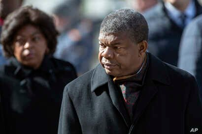 President of Angola Joao Lourenco, center, attends a wreath laying ceremony at the Tomb of the Unknown Soldier by the Kremlin…