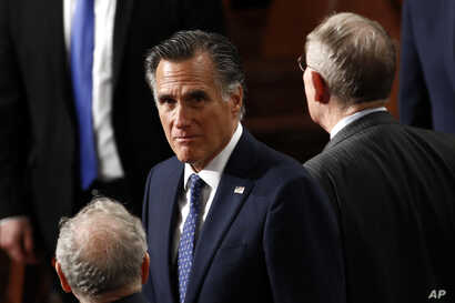 Sen. Mitt Romney, R-Utah, arrives before President Donald Trump delivers his State of the Union address to a joint session of…