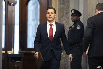 Sen. Ben Sasse, R-Neb., arrives on Capitol Hill in Washington, Friday, Jan. 31, 2020, for the impeachment trial of President…