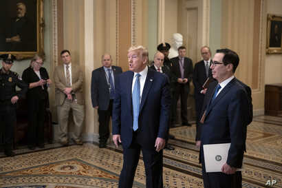 President Donald Trump, joined by Treasury Secretary Steven Mnuchin, right, speaks to reporters after meeting with Republican…
