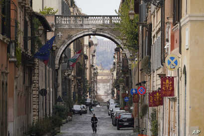 A view of an empty street, in Rome, Saturday, March 21, 2020. Mayors of many towns in Italy are asking for ever more stringent…