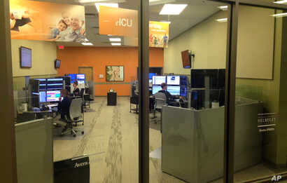 This Monday, June 22, 2015 photo shows Avera Health's telemedicine hub in Sioux Falls, S.D., that provides medical services to…