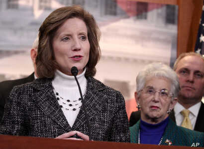 Rep. Vicky Hartzler, R-Mo., left, speaks to reporters on Capitol Hill in Washington, Tuesday, March 25, 2014, after the Supreme…