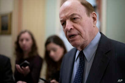 Sen. Richard Shelby, R-Ala., a senior member of the Senate Finance Committee, is asked by reporters about President Donald…